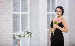 Beautiful young woman with bunch of tulips Stock Photo