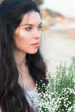 Beautiful young woman with bunch of wildflowers Stock Photos