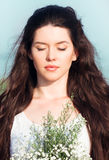 Beautiful young woman with bunch of wildflowers Royalty Free Stock Photography