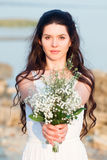 Beautiful young woman with bunch of wildflowers Royalty Free Stock Images