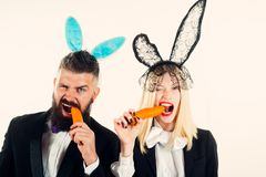 Beautiful young woman with bunny ears and blank poster on color background. Ready for the party. Happy Easter. Beautiful young women with bunny ears and blank stock photos