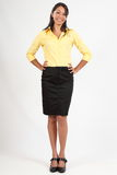 Beautiful young woman in business blouse and skirt Stock Images