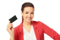 Beautiful young woman with business card. On white background Royalty Free Stock Photography