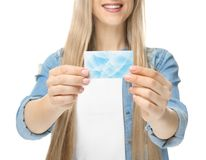 Beautiful young woman with business card. On white background, closeup Stock Photo