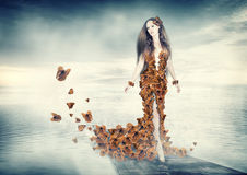 Beautiful young woman in butterflies dress Royalty Free Stock Photos