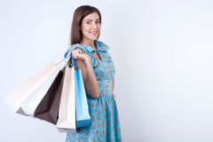 Beautiful young woman is buying clothing with joy Royalty Free Stock Photo