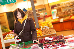 Beautiful young woman buying fruits Stock Image