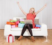Beautiful young woman buying presents Stock Images