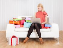 Beautiful young woman buying presents Stock Photography