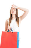 Beautiful young woman buying presents and looking tired Royalty Free Stock Photography