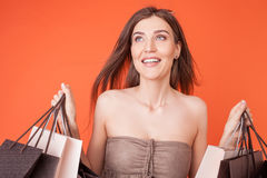 Beautiful young woman is buying things with Royalty Free Stock Images