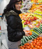 Beautiful young woman buying vegetables Royalty Free Stock Images