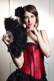 Beautiful young woman cabaret burlesque showgirl portrait with fan Stock Photos