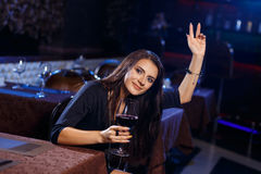 Beautiful young woman calling the waitress Royalty Free Stock Images