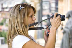 Beautiful young woman with camera Stock Images