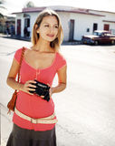 Beautiful young woman with a camera Stock Image