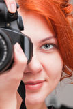 Beautiful young woman with camera Royalty Free Stock Image
