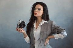 Beautiful young woman with camera stock photos