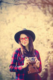 Beautiful young woman with camera standing in front of wonderful Royalty Free Stock Images