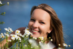 Beautiful young woman with camomiles. Royalty Free Stock Image