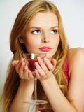 Beautiful young woman with candle in glass Royalty Free Stock Images