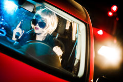 Beautiful young woman in car Stock Photography
