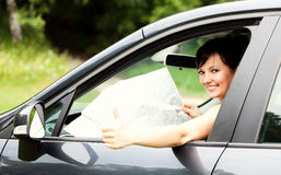 Beautiful young woman in the car, Stock Photo