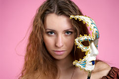Beautiful young woman with carnival Stock Photography