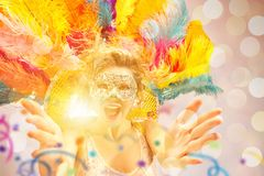 Beautiful young woman in carnival mask royalty free stock image