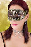 Beautiful young woman in carnival mask. Stock Photography