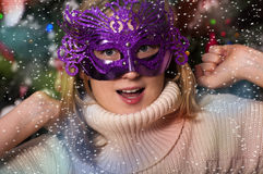 Beautiful young woman in carnival mask Stock Photography