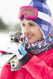 Beautiful young woman carrying skis outdoors Royalty Free Stock Images