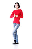 Woman in casual clothes gesturing thumbs up. Royalty Free Stock Images