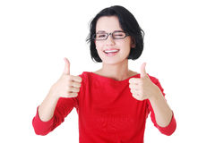 Woman in casual clothes gesturing thumbs up. Stock Images