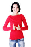 Beautiful woman gesturing thumbs up. Royalty Free Stock Images
