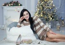 Woman celebrating christmas Stock Photos