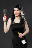 Beautiful young woman celebrating with a glass of champagne Royalty Free Stock Image