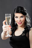 Beautiful young woman celebrating with a glass of champagne Royalty Free Stock Photo