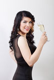 Beautiful young woman celebrating with a glass of champagne Stock Photos