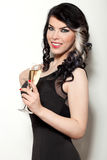 Beautiful young woman celebrating with a glass of champagne Stock Photography