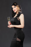 Beautiful young woman celebrating with a glass of champagne Royalty Free Stock Images