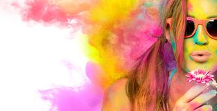 Beautiful young woman celebrating the Holi festival. Colors festival. Beauty spring concept stock photo