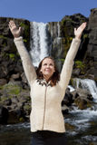 Beautiful Young Woman Celebrating By A Waterfall Stock Photo