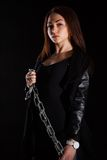 Beautiful young woman with a chain Royalty Free Stock Image