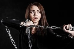 Beautiful young woman with a chain Royalty Free Stock Images