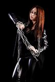 Beautiful young woman with chains Stock Photo