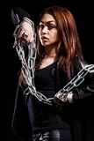 Beautiful young woman with chains Royalty Free Stock Image