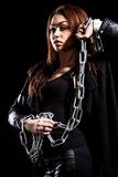 Beautiful young woman with chains Stock Photos