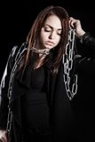 Beautiful young woman with chains Royalty Free Stock Photography