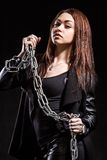 Beautiful young woman with chains Stock Photography